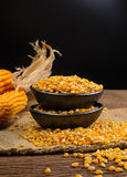 Dried corn in black ceramic bowl on wooden table Royalty Free Stock Photos