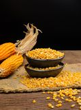 Dried corn in black ceramic bowl on wooden table Royalty Free Stock Photo