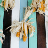 Dried corns is hanged on the roof Royalty Free Stock Images