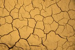 Dried cracked earth soil ground texture background. Mosaic pattern of sunny dried earth soil Stock Photo