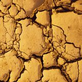 Dried cracked mud suitable as background and climate change symbol. Dried cracked mud suitable as background and symbol of arid climate and climate change cyprus royalty free stock images
