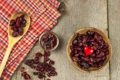 Dried cranberries in a bowl. Healthy super food. Dried cranberries on the kitchen table. Diet food. Royalty Free Stock Photos
