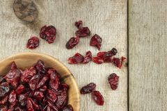 Dried cranberries in a bowl. Healthy super food. Dried cranberries on the kitchen table. Diet food. Royalty Free Stock Photo