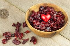 Dried cranberries in a bowl. Healthy super food. Dried cranberries on the kitchen table. Diet food. Stock Photo