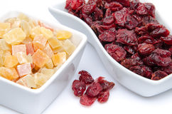 Dried cranberries and candied dried fruits in cups Stock Image