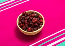 Dried cranberries on canvas close up Stock Photo