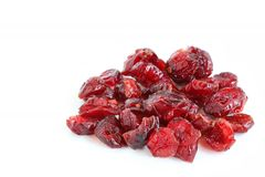 Dried Cranberries. The close up shot of some dried cranberries on white background Royalty Free Stock Photos
