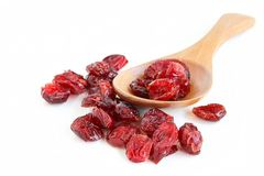 Dried Cranberries. The close up shot of some dried cranberries on white background Stock Image