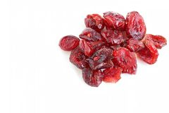 Dried Cranberries. The close up shot of some dried cranberries on white background Stock Photo