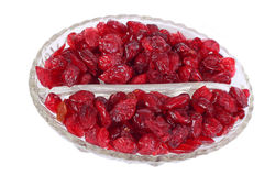 Dried cranberries in the glass bowl. Isolated on white Royalty Free Stock Image