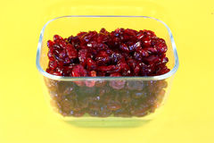 Dried cranberries in glass container Stock Photos