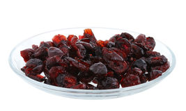 Dried cranberries on glass plate Royalty Free Stock Images