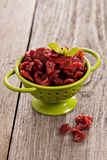 Dried cranberries in a green colander Royalty Free Stock Images