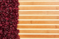 Dried cranberries  lying on a bamboo mat Stock Image