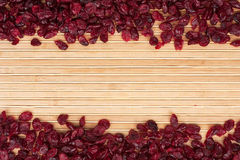 Dried cranberries lying on a bamboo mat Royalty Free Stock Photo