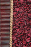 Dried cranberries lying on dark bamboo mat, for menu Royalty Free Stock Images