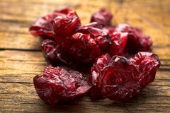 Dried Cranberries on Plank Royalty Free Stock Images