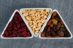 Dried cranberries, raisins and peanuts Stock Photos