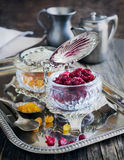 Dried cranberries and raisins in a vintage bowl. Royalty Free Stock Image
