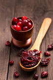 Dried cranberries on a wood spoon Royalty Free Stock Image