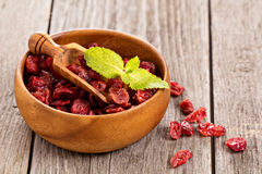 Dried cranberries in a wooden bowl Royalty Free Stock Images