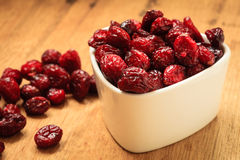 Dried cranberry fruit in bowl on table. Stock Image