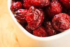 Dried cranberry fruit in bowl on table. Royalty Free Stock Photos