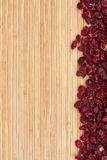 Dried cranberry  lying on a bamboo mat Royalty Free Stock Images