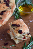 Dried cranberry and rosemary focaccia. With olive oil Stock Images