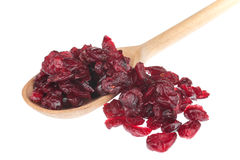 Dried cranberry in a wooden spoon Royalty Free Stock Photos