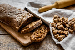 Dried crumbs with bread on kitchen table background Royalty Free Stock Image