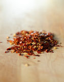 Dried and crushed red peppers Stock Photos