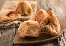 Dried cut figs on a dark wooden spoon. Stock Images