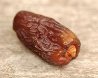 Dried date. Single dried date on plain background Royalty Free Stock Photos