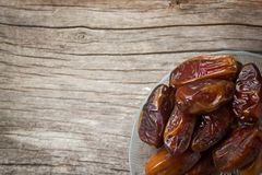 Dried date fruit with hot tea. Stock Image
