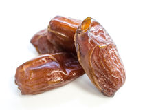 Dried date fruit over white Stock Photos