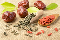 Dried date fruit and tea. On the linen tablecloth stock photo