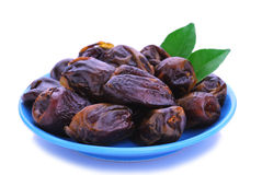 Dried date palm fruit. On the white background stock photo