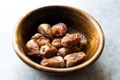 Dried date palm fruits or kurma, ramadan  ramazan  Medjool food in wooden bowl. Organic Fruit Stock Photography