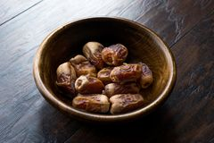 Dried date palm fruits or kurma, ramadan  ramazan  Medjool food in wooden bowl. Organic Fruit Royalty Free Stock Photos