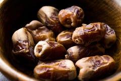 Dried date palm fruits or kurma, ramadan  ramazan  Medjool food in wooden bowl. Organic Fruit Royalty Free Stock Images