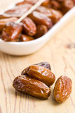 Dried dates. On kitchen table Royalty Free Stock Photo