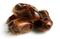 Dried Dates. Dried Mazafati dates close-up Isolated over white background Stock Photography