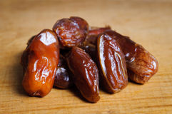 Dried dates. On a wooden plate Stock Images