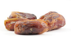 Dried dates. Isolated on white close up in studio Royalty Free Stock Photo