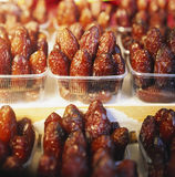 Dried dates. In plastic Punnets Stock Photography