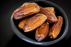 Dried Dates in Black Bowl Royalty Free Stock Photos