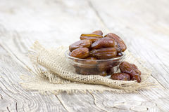 Dried dates in a bowl. On wooden background Stock Images