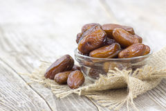 Dried dates in a bowl. On wooden background Stock Image
