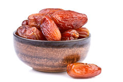 Dried dates in brown cup  on white Royalty Free Stock Images